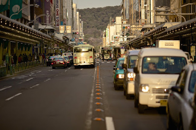 image of a street with cars driving