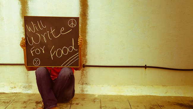 Image of person sitting against wall with sign that says Will write for food