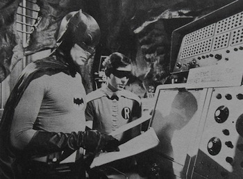 Image of Batman and Robin at a Computer