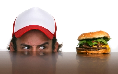 image of guy looking at a hamburger