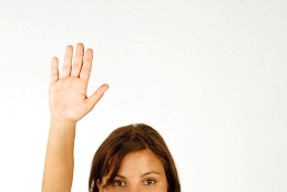 image of woman raising her hand