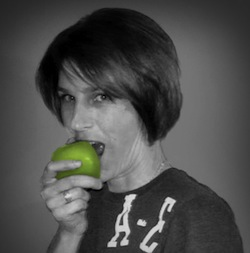 image of female copywriter James Chartrand biting an apple